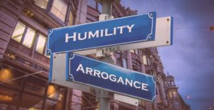 image of a sign with humility and arrogance written on it