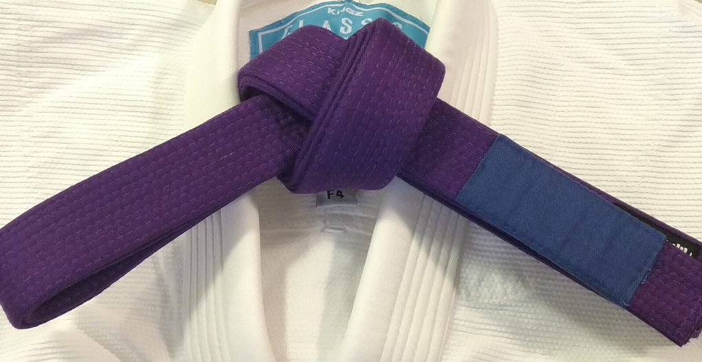 image of gracie jiu jitsu purple belt on a white gi top